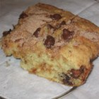 Chocolate Chip Coffee Cake - A tasty sour cream coffee cake with a streak of chocolate chips in the middle.