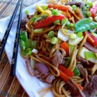 Beef Lo Mein - Mixed vegetables, flank steak, and spaghetti come together for a homemade Asian-style pasta dish you can easily make in under an hour.