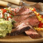 Skillet-Roasted Strip Steaks with Pebre Sauce & Avocado