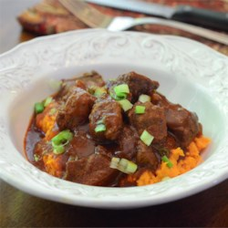 red chile braised beef stew over mashed sweet potatoes printer
