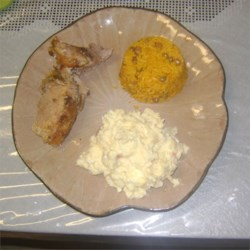 Yellow rice with pigeon peas, pork shoulder and potato salad