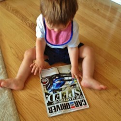 Grandbaby Andrew's favorite reading material - Who'd have thunk?