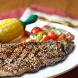 Greek-Seasoned T-Bone Steaks with Cucumber and Tomato Salad