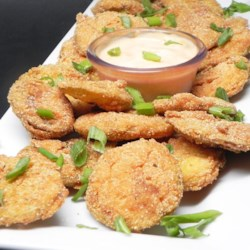 Southern recipes allrecipes easy southern fried green tomatoes recipe cornmeal coated green tomato slices are fried until forumfinder Gallery