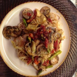 Pasta with Tuna, Sun-Dried Tomatoes, Artichoke Hearts, Lemon, and White Wine Recipe