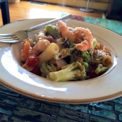 Shrimp, Broccoli Rabe, and Tomatoes Over Penne Pasta Recipe