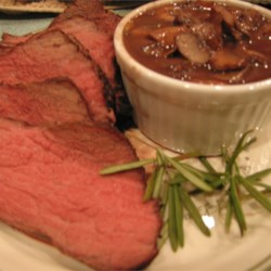 Boneless Garlic and Rosemary Rubbed Prime Rib with Red Wine Mushroom Sauce