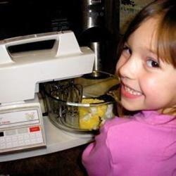 Raylynne helping Grandma bake!