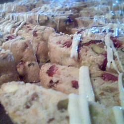 Cranberry Pistachio Biscotti with White Chocolate Drizzle