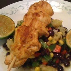 Lime Chili Chicken Kabob served on a bed of Pineapple Salsa