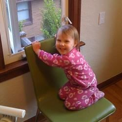 My daughter, listening to our Bluegrass neighbors through the window