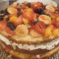 White cake with fruit and whipped cream