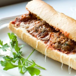 Sandwich recipes allrecipes meatball sandwich recipe and video meatballs in tomato sauce with melted cheese on a lightly forumfinder Image collections