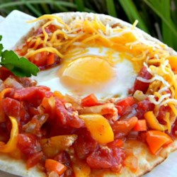 Vegetarian main dish recipes allrecipes chef johns shakshuka recipe and video a spicy tomato and pepper sauce is slowly simmered forumfinder Gallery