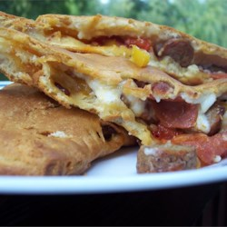 Quick Sausage and Bell Pepper Calzones Recipe