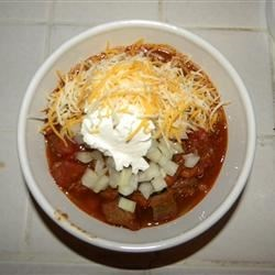 Steak Chili with fresh onionm cheese, and sour cream