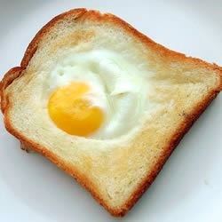egg in a basket (or toad in the hole)