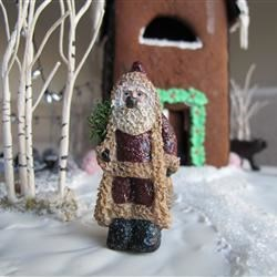 Belsnickle Santa with gingerbread house and bear in the background.