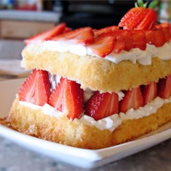 Strawberry cream cake with whipped cream frosting