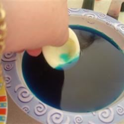 Egg white halves into the food coloring
