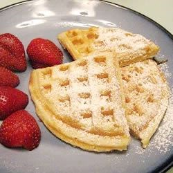 Norwegian Waffles with powdered sugar and strawberries