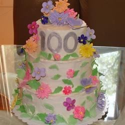 the theme of the 100th birthday party was grebera daisy's This was m 1st time making flowers