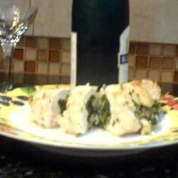 Chicken breast with crumbled spinich, blue cheese and bacon roll