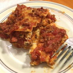 Italian recipes allrecipes american lasagna recipe and video making this lasagna a day ahead and refrigerating overnight allows forumfinder Choice Image