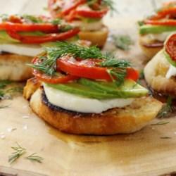 Roasted Tomato, Avocado, and Fresh Mozzarella Crostini