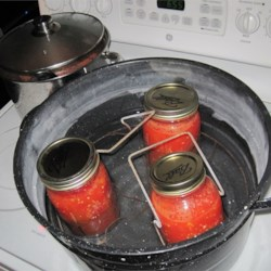 Water bath with tomato stewing pot in background)