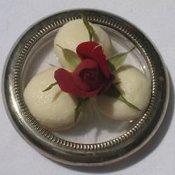 Rasgullas in Rose Syrup