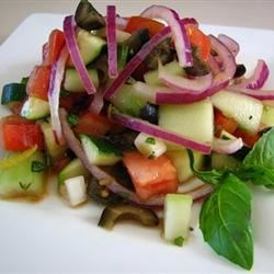 Photo of Cucumber Tomato Salad with Zucchini and Black Olives in Lemon Balsamic Vinaigrette by DZAHRA