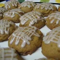Pumpkin cookies with powdered sugar icing