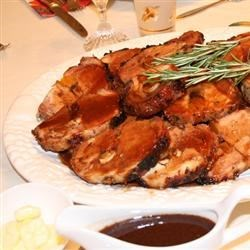 Photo of Rosemary-Scented Pork Loin Stuffed With Roasted Garlic, Dried Apricots and Cranberries and Port Wine Pan Sauce by USA WEEKEND columnist Pam Anderson