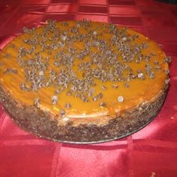 Chocolate Caramel Cheesecake w/ caramel & Mini Morsel Topping