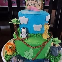 Jungle-themed baby shower cake