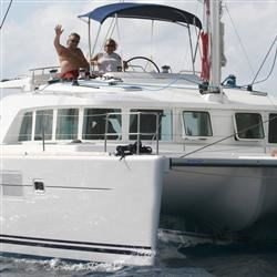Joe & Carol on their crewed charter catamaran in the BVI