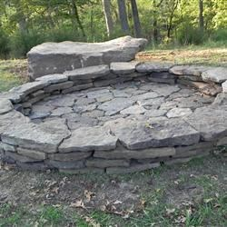 Our new fire pit DH did using native stone from our property