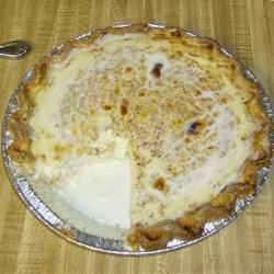 Grandma's Egg Custard Pie, With A Little Melted Whip Cream On Top!