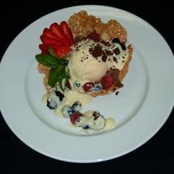 Vanilla Bean Ice Cream in an Almond Tuille Basket with Fresh Berries and Creme Anglaise