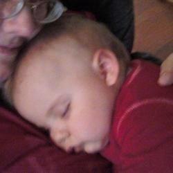 My Tabby sleeping on Grandma