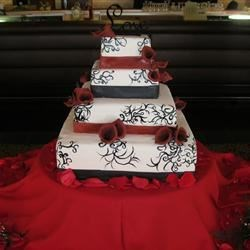 4 tier, fondant covered, chocolate mousse filled, sugar flowers, hand painted scrool