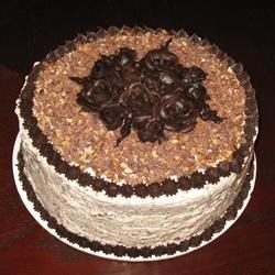Candy Bar Cake Icing on Black Magic Cake with chocolate cream cheese decor.