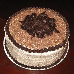 Candy Bar Cake Icing on Black Magic Cake with chocolate cream cheese decor.