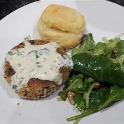 Crab cake with salad and biscuit