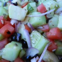 Cucumber Tomato Salad with Zucchini and Black Olives in Lemon Balsamic Vinaigrette