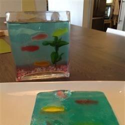 "Aquarium Jell-O, with Swedish Fish and rock candy ""rocks."""