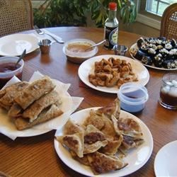 Gyoza, Egg Rolls, Chicken Satay and Smoked Salmon Sushi