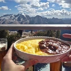 An airlifted meal at 3150 m. The background: the Marmolada–Queen of the Dolomites–only 150m higher