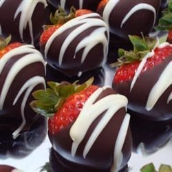 Chocolate covered strawberries drizzled with melted white chocolate